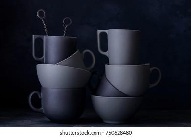 Dark ceramic kitchenware. Black ang grey cups, bowls
