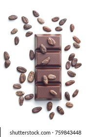 Dark chocolate bar and cocoa beans isolated on white background. Top view.
