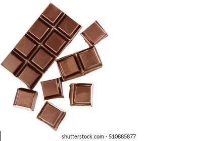 Dark chocolate bar and cubes isolated on white background, top view