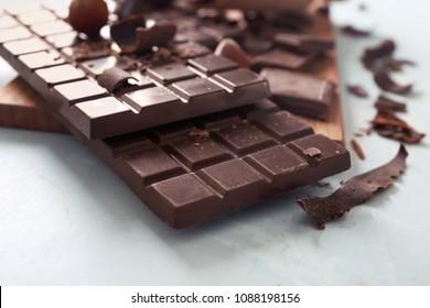 Dark chocolate bars on table