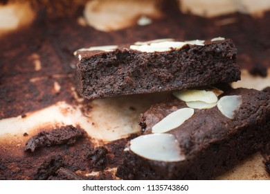 Dark chocolate brownies with almond topping.