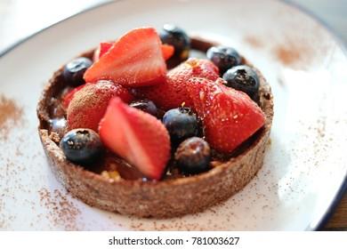 dark chocolate cake fruit on top