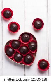 Dark chocolate candies in heart shape