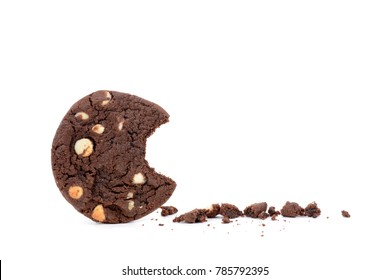 dark chocolate chip cookie with a bite and crumbs white background