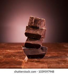Dark chocolate on a marble brown background