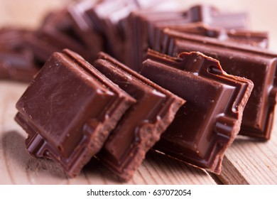 Dark chocolate pieces on dark gray background