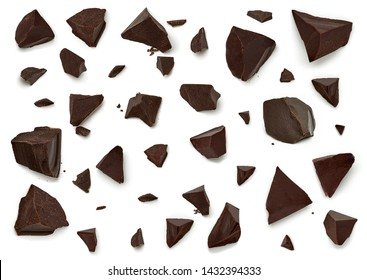 Dark chocolate pieces or parts isolated on white background
