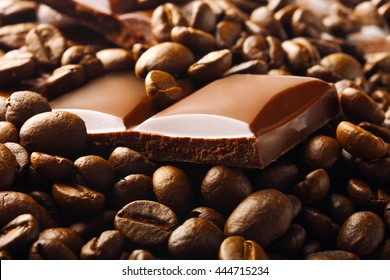dark chocolate pieces in roasted coffee beans