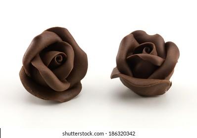 dark chocolate roses on white background