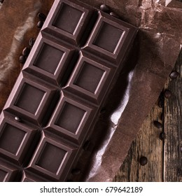 Dark chocolate stack, on wooden table,chocolate concept background