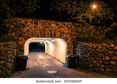 Dark city bridge with underpass tunnel at night