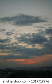 dark cloud above dusk sky
