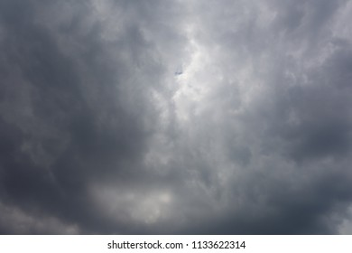 Dark cloud overcast sky in hot humid summer afternoon. Sun tries to come out between the space of clouds. Great for background work. Add own text and message.