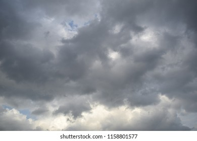 dark cloud and some of bright clouds at the top with bright blue color sky.