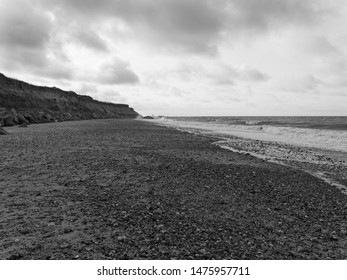 Dark clouds begin to gather over Happisburgh beach