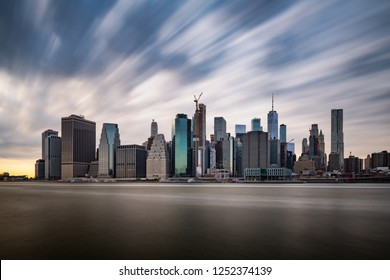 Dark clouds comming quickly over the New York Lower Manhattan during cloudy day in a long exposure panorama photograph