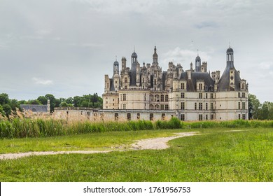 Dark clouds and dramatic scene over Chateau Chambord .Castle with very distinctive French Renaissance architecture