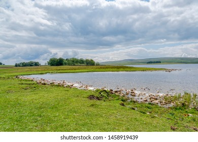 Dark clouds gather over Malham Tarn in the Yorkshire Dales.