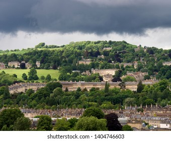 Dark clouds loom over Georgian architecture of Bath in Somerset, UK.