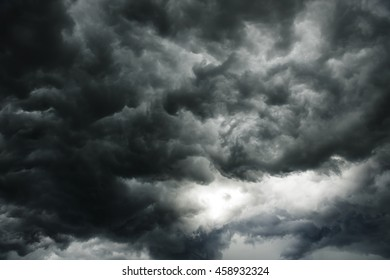 the dark clouds make the sky in black. The rain is coming soon. Pattern of the clouds can not predict this is  tornado, Hurricane or thunderstorm. Sometimes heavy clouds but no rain