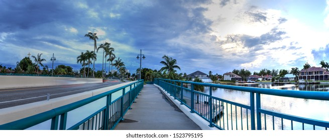 Dark clouds over Herbert R. Savage bridge, over Savage Pass, at the entrance of Marco Island, Naples, Florida