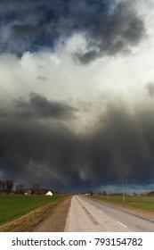 Dark clouds over land.