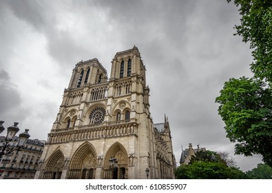 Dark clouds over wide angle view of Notre Dame Cathedral in Paris, France
