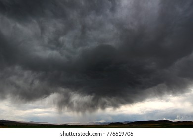 Dark clouds and precipitation from a thunderstorm in rural Idaho