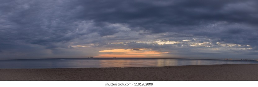 Dark, cloudy and moody sunrise at the beach. Cold september at the sea