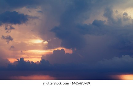 Dark cloudy sky at sunset, natural background photo