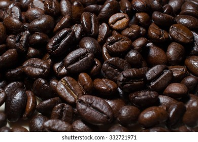 Dark coffee beans. May be used as background