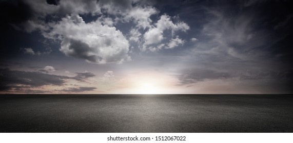 Dark Concrete Floor and Panoramic Atmospheric Clouds with Sunset Sky Horizon Cinematic Background