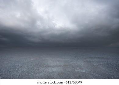 Dark concrete scenery background with dramatic sky