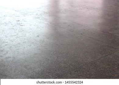 Dark concrete surface, the sun shines.