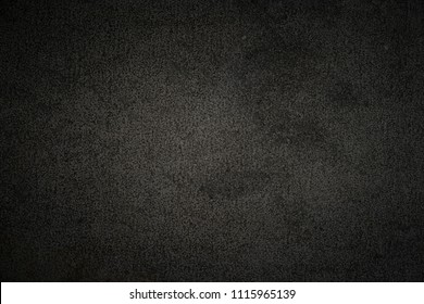 Dark concrete texture with center soft light