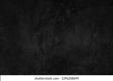 Dark concrete textured wall background.black cement wall texture for interior design. dark edges.copy space for add text.
