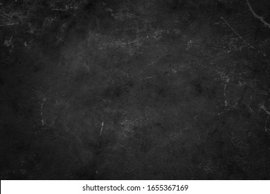 Dark concrete textured wall background.black grunge cement wall texture for interior design. dark edges.copy space for add text.
