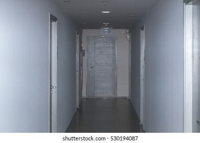 Dark corridor with cabinet doors