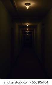 dark corridor with glowing lamps on the ceiling
