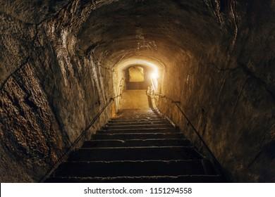 Dark corridor of old abandoned underground Soviet military bunker. Staircase goes down, Sevastopol, Crimea.