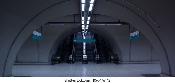Dark corridor and tunnel in a metro station. Lights and subway