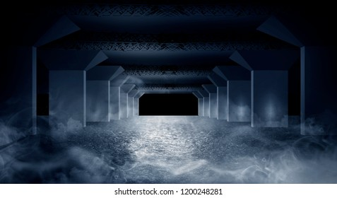 Dark corridor of the underground garage, street exterior, neon light. Abstract dark background of street asphalt with smoke, rays of searchlights in tunnels