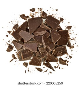 Dark Cracked chocolate pile top view isolated on white background