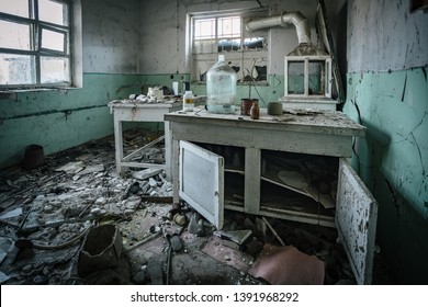 Dark creepy abandoned chemical laboratory, broken glassware
