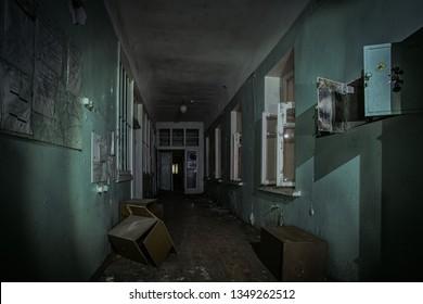 Dark creepy corridor of abandoned hospital