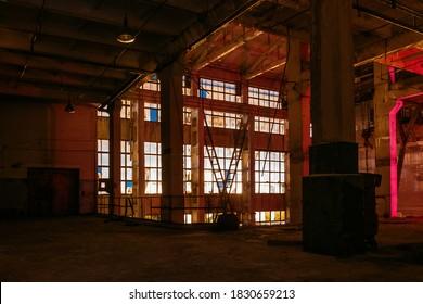 Dark creepy empty abandoned industrial building interior at night