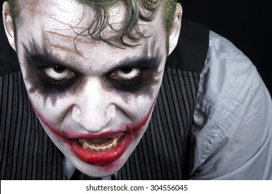 Dark creepy joker face screaming angry