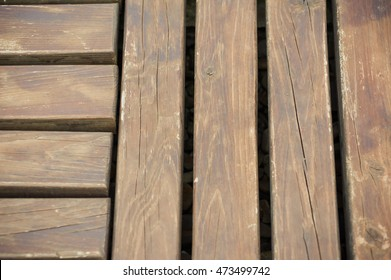 dark deck board and deck chairs by the outdoor pool