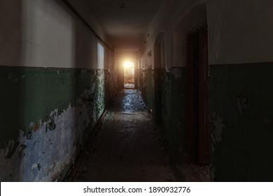 Dark dirty corridor of old abandoned building.