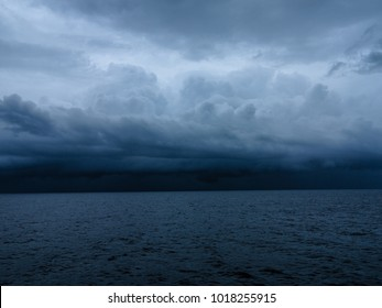 Dark & Dramatic blue sky and dark & Dramatic blue sea color and dark storm raining cloud background.